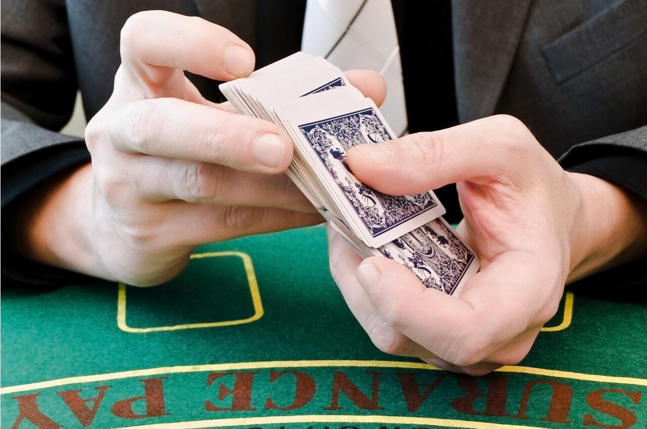 Hands shuffling playing cards